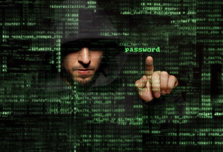 security: Silhouette of a hacker uses a command on graphic user interface