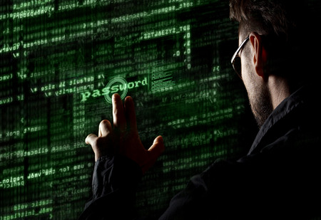 Silhouette of a hacker uses a command on graphic user interface Imagens - 30207383