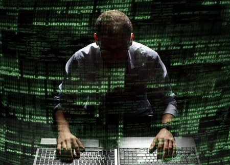 Silhouette of a hacker uses a command on graphic user interface Imagens - 30206033