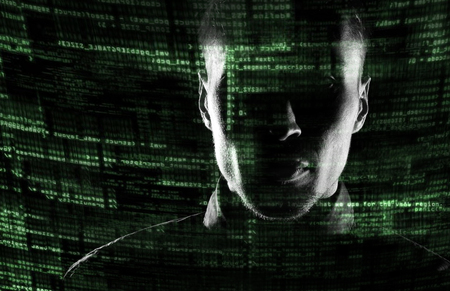computer crime: Silhouette of a hacker uses a command on graphic user interface