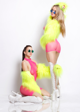 Go-go dancers Two attractive sexy girls in fetish outfits Studio shot photo