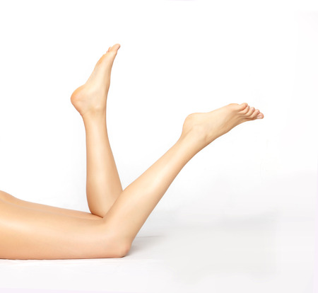 Female legs isolated on white. Depilation or another healths concept