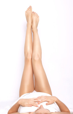 long legs: Female legs isolated on white. Depilation or another healths concept