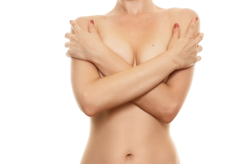 woman naked body: Topless woman body covering her breast with hand, isolated on white. Breast cancer concept