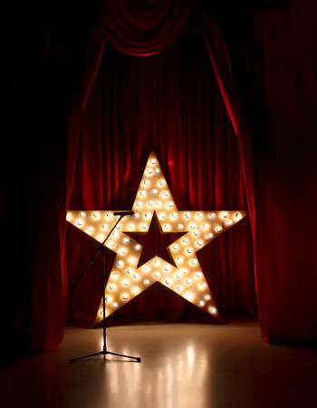 shows: Microphone on theater stage,golden star  with red curtains around