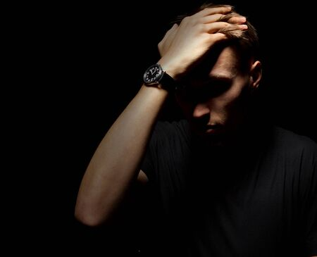 one young man: Grief. Man closed face, negative emotions cry or grief Stock Photo