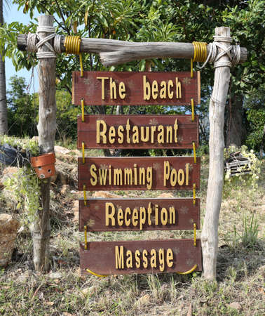 wood sign: To the beach