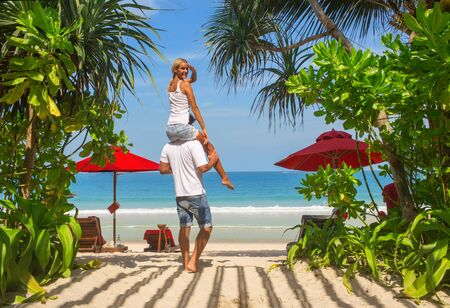 young tree: Happy couple on the sand Thailand beach