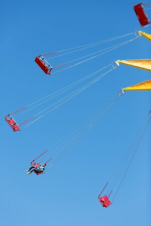 chairoplane: circular swing. photo on the background of sky swing at an amusement park Stock Photo