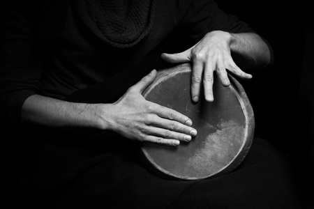 african drums: black and white photo of hand drum Stock Photo
