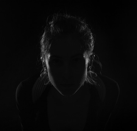 head and  back: Hidden face in the shadow. female silhouette. Stock Photo