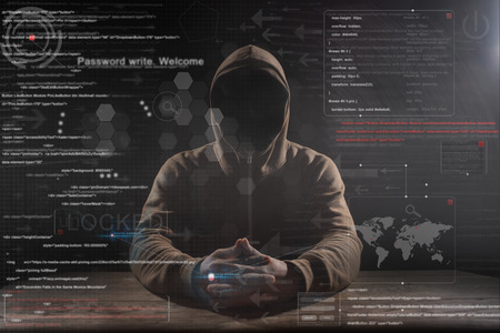hacker at work with graphic user interface around Stock Photo