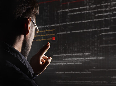 hacker silhouette with graphic user interface around Stock Photo
