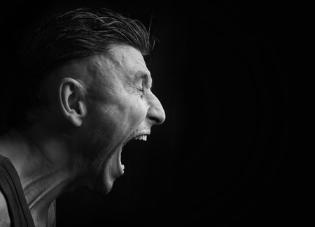 male face profile: screaming man Stock Photo