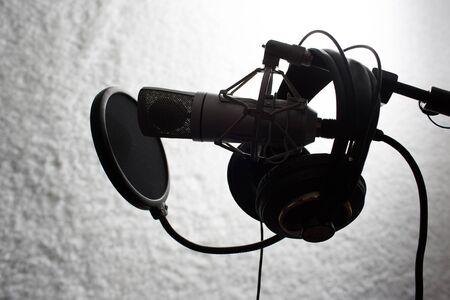sihouette: studio microphone and headphones sihouette