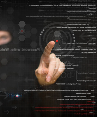 user: hacker at work with graphic user interface around Stock Photo