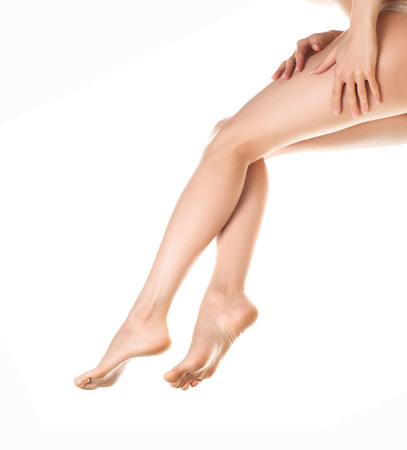 woman legs isolated on white. Depilation or another healths concept Stock Photo