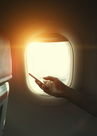 flight mode: holding mobile phone with flight mode in the airplane