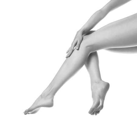women legs: woman legs isolated on white. Depilation or another healths concept Stock Photo