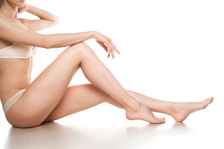smooth: woman legs isolated on white. Depilation or another healths concept Stock Photo