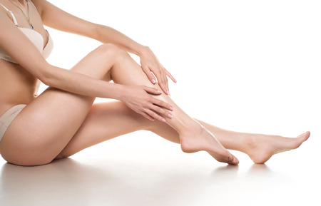 female legs: woman legs isolated on white. Depilation or another healths concept Stock Photo