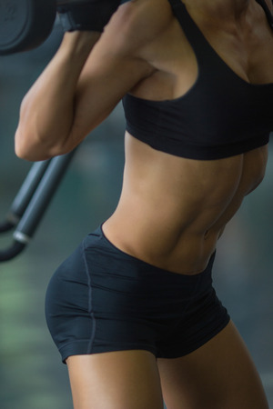 squats: In the gym.fitness model doing squats