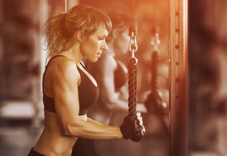 Muscular fitness woman doing exercises.Concept of healthy lifestyle. Cross fit bodybuilder  in the gym. Stock Photo