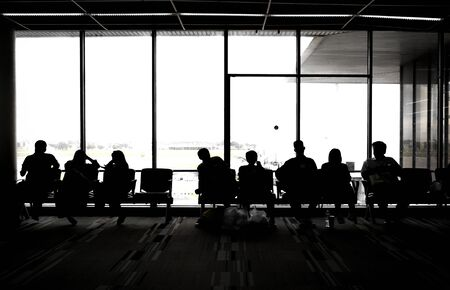 busy person: Silhouette of people waiting on airport