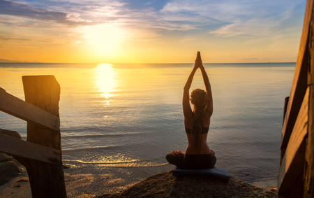 serenity and yoga practicing at sunset,meditation Standard-Bild