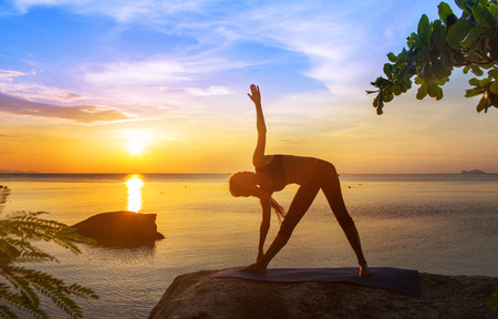 serenity and yoga practicing at sunset,meditation Stock Photo
