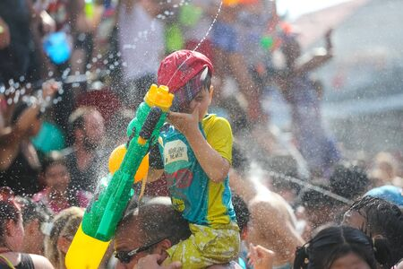 Koh Phangan island, Thailand - April 13 2017: Unidentified tourists shooting water on Songkran Festival ( Thai New Year ) at Thongsala streets