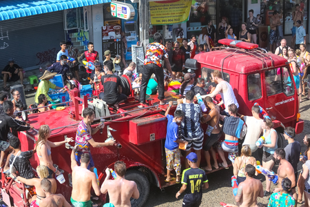 drenched: Koh Phangan island, Thailand - April 13 2017: Unidentified tourists shooting water on Songkran Festival ( Thai New Year ) at Thongsala streets