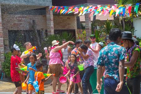 Koh Phangan island, Thailand - April 13 2017: Unidentified tourists shooting water on Songkran Festival ( Thai New Year ) at Thongsala streets