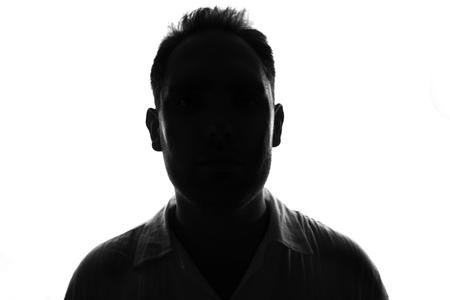Male person silhouette,back lit over white Stock Photo