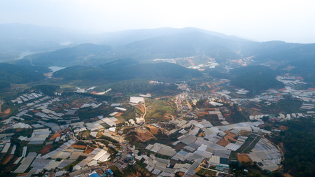 Aerial view e to Dalat city roofs and farms.Located on the Langbian Plateau in the southern parts of the Central Highlands region of Vietnam