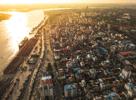 Aerial  shot,view from the drone on the road junction and city of Yangon near Rangoon river at sunset colors ,Myanmar