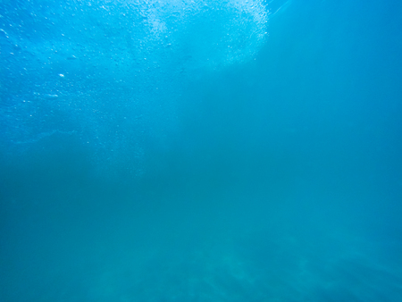 Underwater bubbles with sunlight through water surface, natural scene Stock Photo