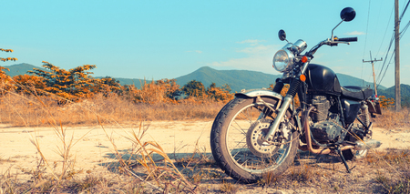 Motorbike under sky.Vintage color photo effect added Imagens