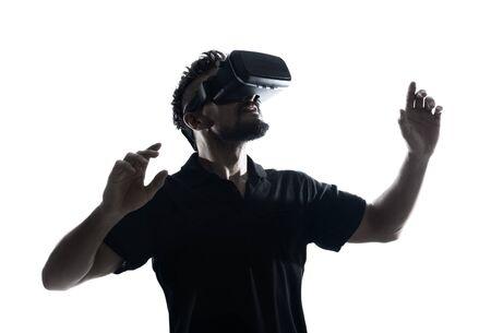 Man in dark T-shirt wearing virtual reality 3D headset