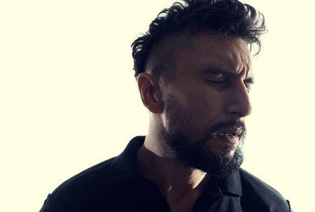 Dramatic profile portrait of male person