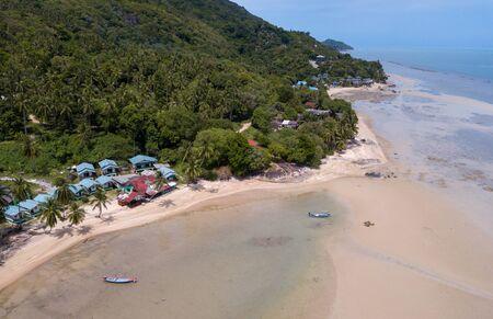 Aerial shoreline with fishing thai boats parking along the sand beach, Baan Tai area, koh Phangan island, Thailand