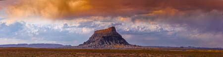 san rafael: Factory Butte is the most recognizable feature of a large area of stark, barren land either side of the Fremont River known as the Upper Blue Hills, bordered by Capitol Reef to the west, the Henry Mountains to the south, San Rafael Swell to the north and  Stock Photo