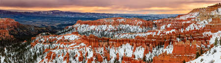 bryce: A rare view of the Bryce Canyon National Park natural amphitheaters in the snow during winter sunrise. Utah, USA. Stock Photo