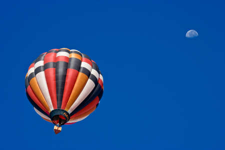Colorful hot air balloon in morning air Фото со стока