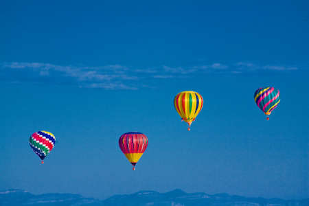 Colorful hot air balloons in mid air