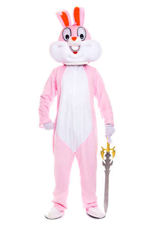 Life size easter bunny knight or warrior with sword or dagger stands on white background
