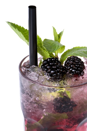 Close up of Mojito blackberry cocktail on a white background