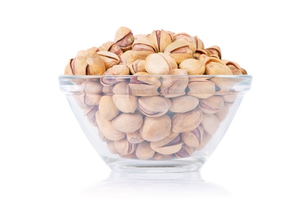 Close up view of phistachio nuts on a white background Stock fotó