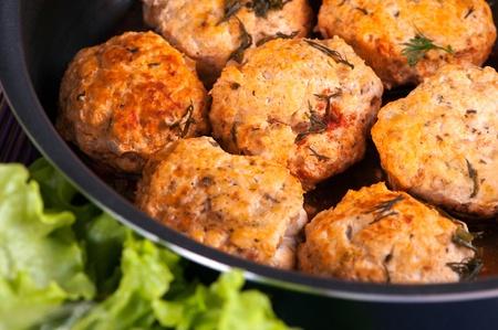 Cooked pork meat balls in a frying pan Stock fotó
