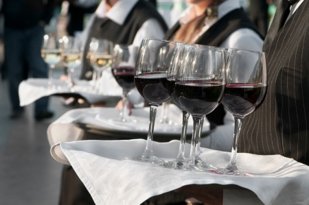 lunch tray: Waiter with dish of wine glasses  Stock Photo